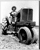 Farmer Sitting on a Tractor in a Field Fine-Art Print