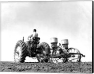 Low Angle View of a Farmer Planting Corn with a Tractor in a Field Fine-Art Print