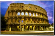 Low angle view of the old ruins of an amphitheater lit up at dusk, Colosseum, Rome, Italy Fine-Art Print