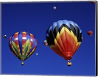 Two Hot Air Balloons Flying Away Together Fine-Art Print