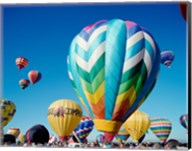 Low angle view of hot air balloons taking off, Albuquerque International Balloon Fiesta, Albuquerque, New Mexico, USA Fine-Art Print