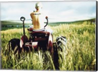Rear view of a farmer driving a tractor in a field, Oregon, USA Fine-Art Print
