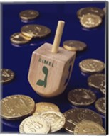 Close-up of a Hanukkah dreidel with Hanukkah gelts Fine-Art Print