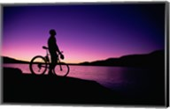 purple Silhouette of a man standing with mountain bike, Lake Powell, Utah Fine-Art Print