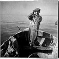 Hauling in a cod aboard a Portuguese fishing dory off Cape Cod, Massachusetts Fine-Art Print