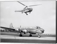 Low angle view of a helicopter in flight and an airplane at an airport, Sikorsky Helicopter, Douglas DC-4 Fine-Art Print
