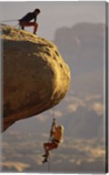 View of rock climbers on the edge of a cliff Fine-Art Print