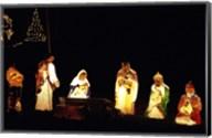 Figurines depicting nativity scene lit up at night Fine-Art Print