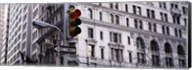 Low angle view of a Red traffic light in front of a building, Wall Street, New York City Fine-Art Print