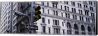 Low angle view of a Green traffic light in front of a building, Wall Street, New York City Fine-Art Print