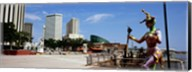 Jester statue with buildings in the background, Riverwalk Area, New Orleans, Louisiana, USA Fine-Art Print
