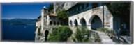 Walkway along a building at a lake, Santa Caterina del Sasso, Lake Maggiore, Piedmont, Italy Fine-Art Print