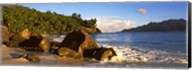 Waves splashing onto rocks on North Island with Silhouette Island in the background, Seychelles Fine-Art Print