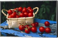 Still life of cherry tomatoes in a rectangular woven basket sitting on distressed blue painted table top Fine-Art Print