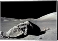 Astronaut standing near a rock on the moon, Apollo 17 Fine-Art Print