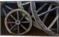 Rustic wagon wheels on movie set, Cuba Fine-Art Print