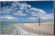 Woman walking on white sand beach of Beachcomber Island, Mamanucas Islands, Fiji Fine-Art Print