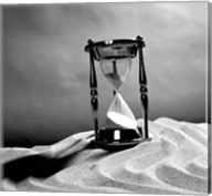 Close up of hourglass on sand Fine-Art Print