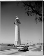 USA, Mississippi, Biloxi, Biloxi Lighthouse with street in the foreground Fine-Art Print