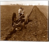 USA, Pennsylvania, Farmer on Tractor Plowing Field Fine-Art Print