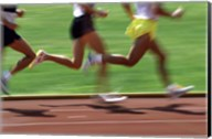 Low section view of male athletes running on a running track Fine-Art Print