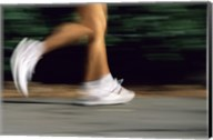 Low Section View Of A Person Running In White Sneakers Fine-Art Print