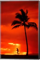 Silhouette of a man running by a palm tree at sunset, Maui, Hawaii, USA Fine-Art Print