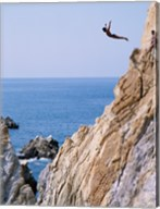 Male cliff diver jumping off a cliff, La Quebrada, Acapulco, Mexico Fine-Art Print