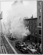 New York City, Fire on East 47th Street, with fire engines shooting water on burning building Fine-Art Print