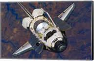 The Space Shuttle Discovery approaches the International Space Station Fine-Art Print