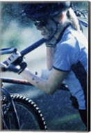 Young woman carrying a bicycle on her shoulders Fine-Art Print