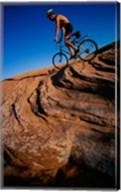 Low angle view of a man mountain biking, Utah, USA Fine-Art Print