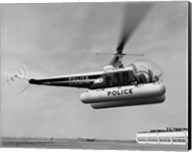 Low angle view of a helicopter in flight, Bell 47-D, Bell Aircraft Corporation Fine-Art Print
