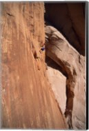 Low angle view of a man climbing a mountain, Utah, USA Fine-Art Print