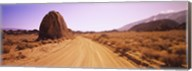 Dirt road passing through an arid landscape, Californian Sierra Nevada, California, USA Fine-Art Print
