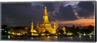 Buddhist temple lit up at dawn, Wat Arun, Chao Phraya River, Bangkok, Thailand Fine-Art Print