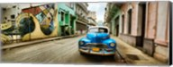 Old car and a mural on a street, Havana, Cuba Fine-Art Print