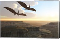Two Pterodactyl flying dinosaurs soar above a beautiful canyon Fine-Art Print