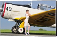1940's style Navy pin-up girl leaning on the wing of a T-6 Texan Fine-Art Print
