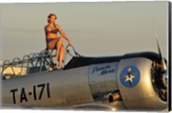 1940's style pin-up girl sitting on the cockpit of a World War II T-6 Texan Fine-Art Print