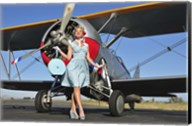 Elegant 1940's style pin-up girl standing in front of an F3F biplane Fine-Art Print