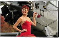 Redhead pin-up girl in 1940's style dancer attire holding on to a vintage aircraft propeller Fine-Art Print