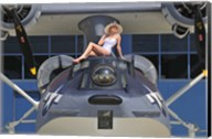 Retro pin-up girl posing with a World War II era PBY Catalina seaplane Fine-Art Print