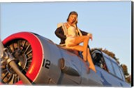 1940's style aviator pin-up girl posing with a vintage T-6 Texan aircraft Fine-Art Print