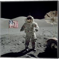 Apollo 17 Astronaut Stands near the American flag on the lunar surface Fine-Art Print